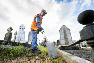 28/10/2015  Over 40 staff from Limerick Civic Trust conducted a giant clean-up of Mount Saint Lawrence Cemetery in advance of All Souls Day.  Pictured is Jason Hanlon.  The Mass Clean-Up was part of ongoing work by Limerick Civic Trust in Mount Saint Lawrence Cemetery.  Staff at the Trust have already restored and repaired 50 graves and tended to over 150 graves in Mount Saint Lawrence.   Limerick Civic Trust is also involved with the restoration of the Mortuary Chapel at Mount Saint Lawrence cemetery.  Work is progressing steadily with the total restoration and refurbishment of the apse roof near completion. The Limerick Civic Trust, which was formally constituted in 1983, is an independent, non-profit making voluntary society. It is mainly supported from donations by industry, business, charitable trusts and individuals. Its mission is to improve Limerick's city environment through positive action.  Picture credit: Diarmuid Greene/Fusionshooters